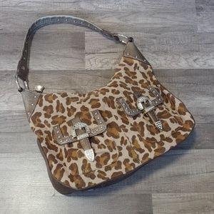 Kathy van Zeeland gold leopard buckle purse